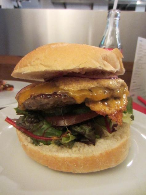 Cheese burger with mustard and ketchup