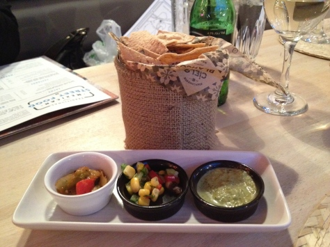 Tortilla chips with accompaniments.