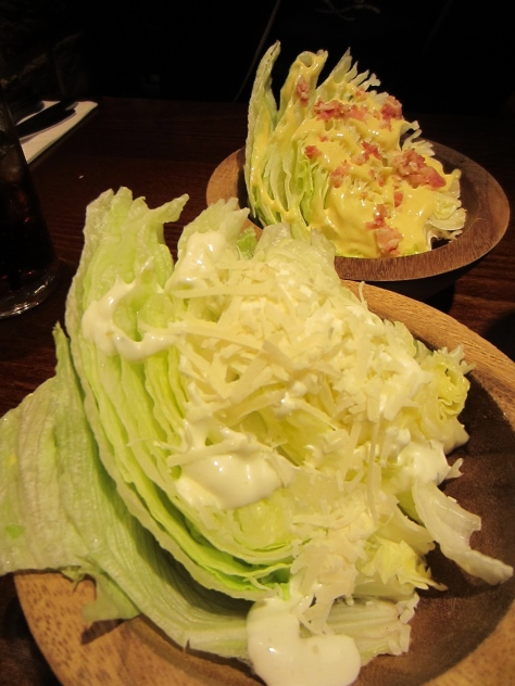 Iceberg lettuce wedge with bacon and honey mustard, garlic and chive mayonnaise with parmesan.
