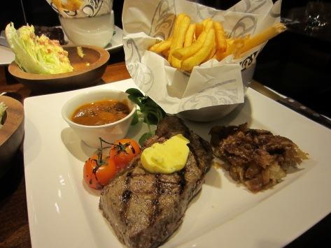 Sirloin steak, with garlic butter and mushroom chasseur sauce.