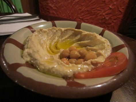 Humous topped with olive oil and chickpeas.