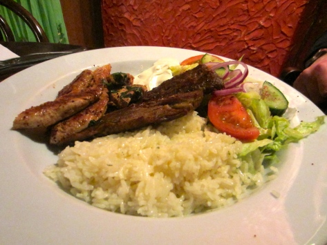 Mixed grill with lamb and chicken fillet, kofta with rice, salad and a yoghurt sauce.
