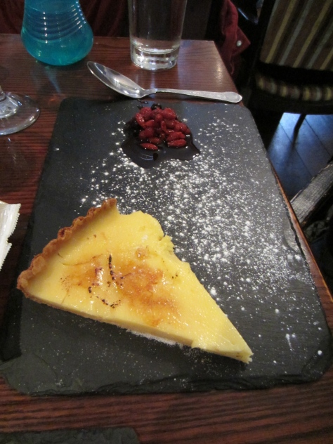 Lemon tart with goji berry compote.