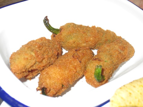 Jalapeño poppers - crispy coated spicy peppers filled with Jack and cream cheese.