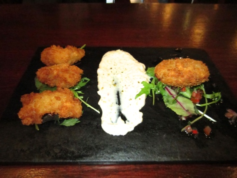 Crispy langoustine tails and crab cake with tomato and shallot dressing.
