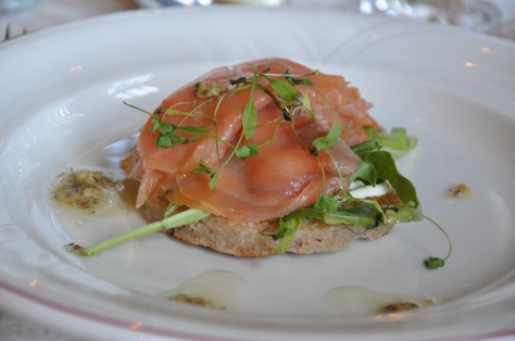 Smoked salmon blini wth creme fraiche, a dill and