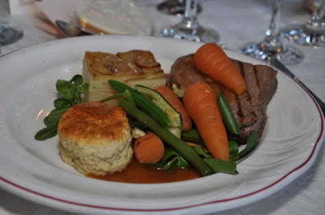 Carlton grazed fillet of beef with thyme scone, dauphinoise potatoes and a burgundy and oxtail sauce