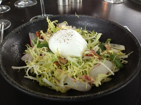 Crisp dry cure bacon, poached egg, fine bean, frisee, mustard dressing