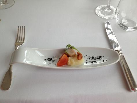 Amuse bouche, sea bass with celery purée, tomato