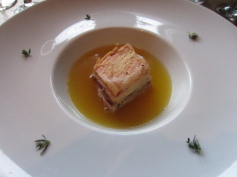 Own made spaghetti - Saffron consommé, sous vide pork belly and lobster spaghetti