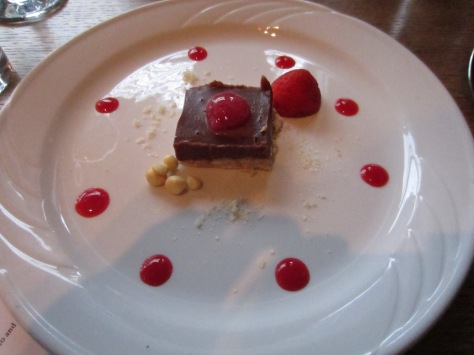 Chocolate surprise - Chocolate pave, gold pebbles and raspberry ravioli