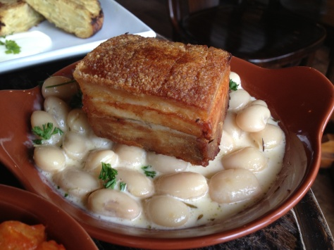 Alubias estofadas con panceta - roasted pork belly with a white bean and truffle cassoulet