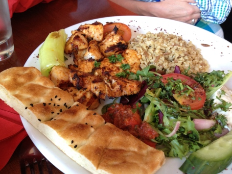 Chicken skewers - grilled marinated chicken fillets with rice, salad and homemade bread