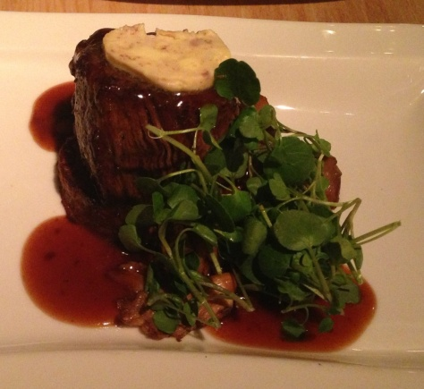 6 oz fillet of beef with oyster mushroom, whole confit of garlic, roasted bone marrow butter, potato rosti, pan jus