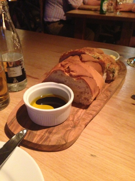A selection of breads with olive oil and balsamic vinegar.