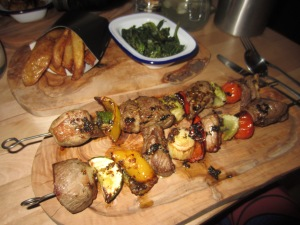 Lamb rump skewers with collard greens and chunky chips