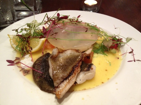 Pan fried turbot, served with a shellfish and vegetable coral bed, with a smoking saffron broth