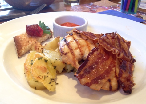 Grilled chicken breast with crispy pancetta spicy tomato sauce & roast potatoes