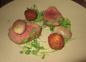 Fillet of butchers farmers beef - bone marrow and oxtail croquettes, slow cooked shallots, oxtail jus and watercress emulsion