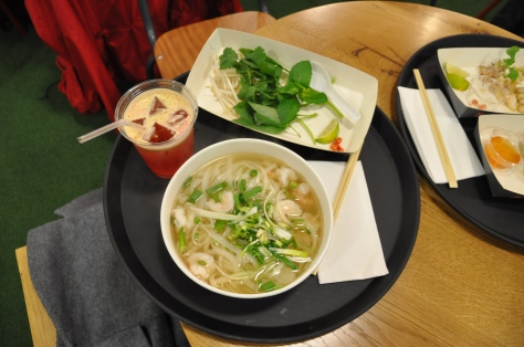 Phở tôm: with tiger prawns, a side plate of fresh herbs and a Cranberry and orange juice