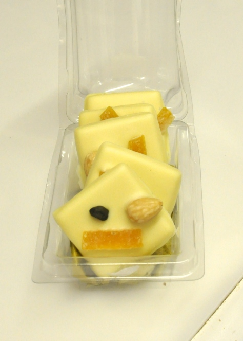 Median - white chocolate with almond, pistachio and candied orange