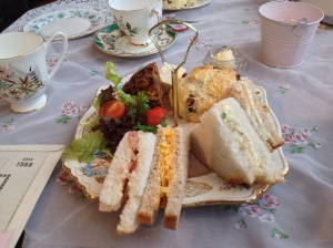 Afternoon tea for one - sandwiches, fruit scone, fruit cake, cheese and salad