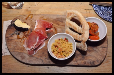 Botanist Deli Board with cous cous and seed salad, home dried tomatoes, cured parma ham and Sharrock's 2 year aged Lancashire