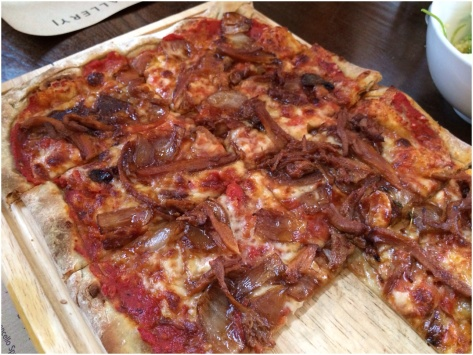 Spiced pork & roasted balsamic onion pizza