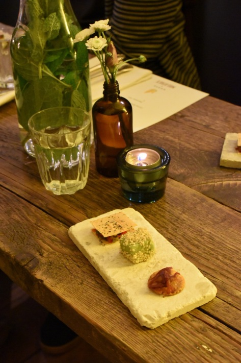 Snacks - Taco revisited with Harissa and cottage cheese, Avocado parfait & sesame, Yorkshire cheese on a sable biscuit with Wensleydale and pickled rhubarb